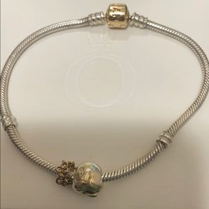 Pandora 14k gold clip and two charms